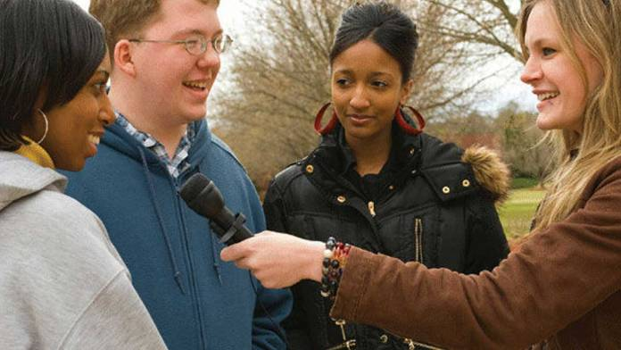 group being interviewed with hand held microphone