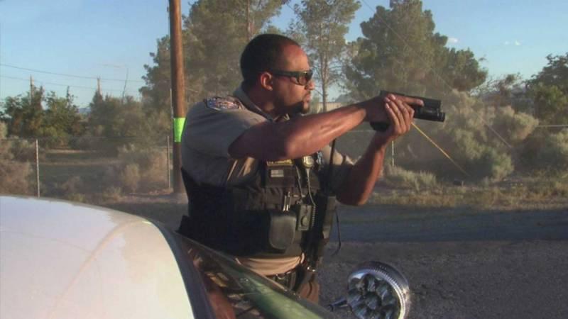 Policeman with drawn gun