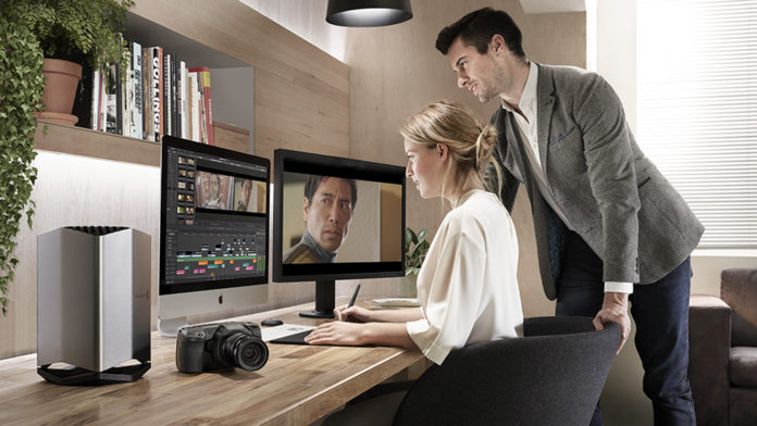 A Man and woman editing on a computer