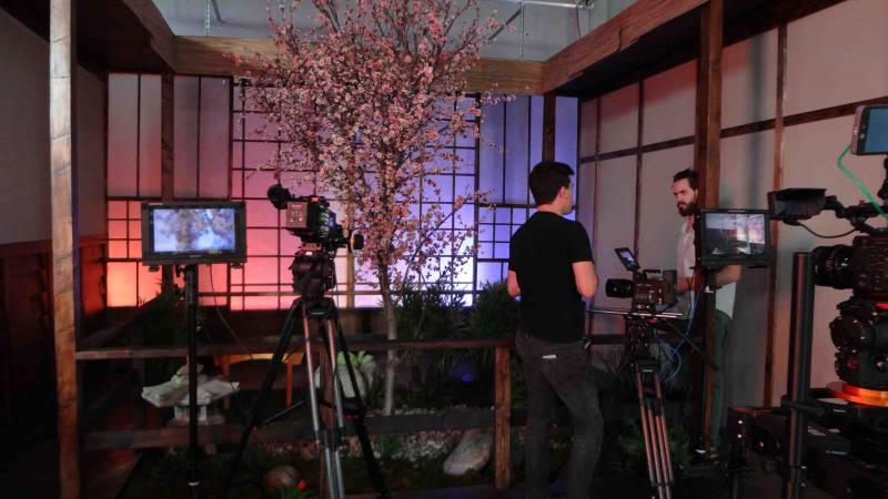 tow men and camera gear in the Sigma Cine Burbank Japan room