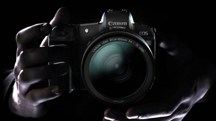 Hands holding Canon EOS R