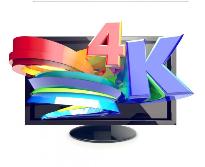 """Colorful image of text """"4K"""" popping out of display screen."""