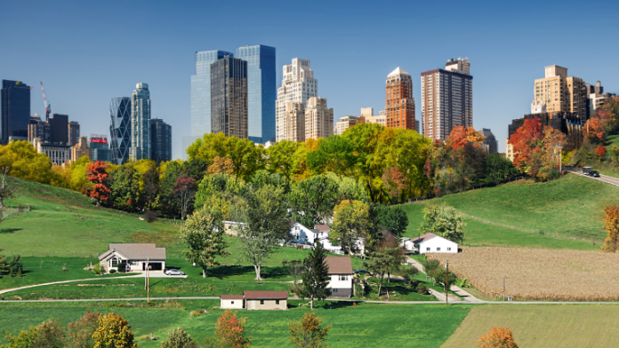 Country scene with NYC skyline in background.