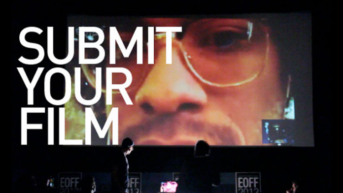 """Movie theater with """"Submit Your Film"""" on the screen"""