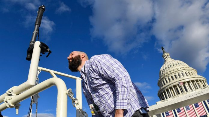 Jan 19, 2017; Washington, DC, USA; Anthony Fox of USA TODAY sets up a test rig of a specially modified Nikon KeyMission 360 on the center camera tower during preparations the 2017 Presidential Inauguration at the U.S. Capitol. Mandatory Credit: Jack Gruber-USA TODAY