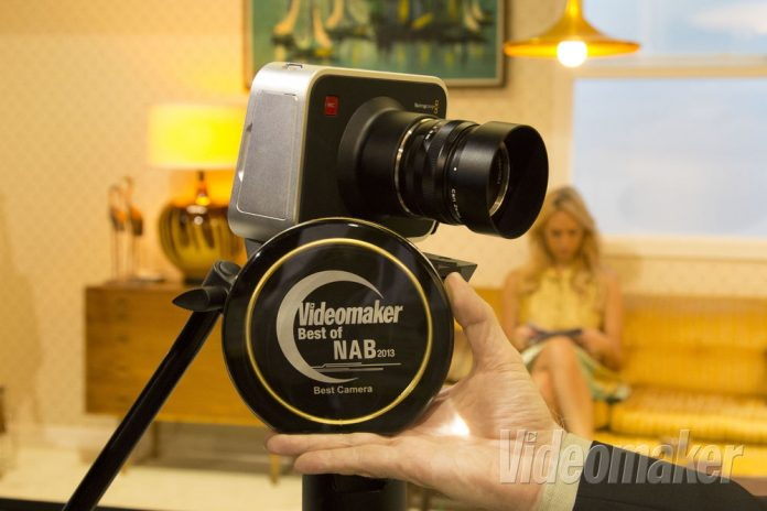 Blackmagic Production Camera 4K rests on a tripod with an award held in front