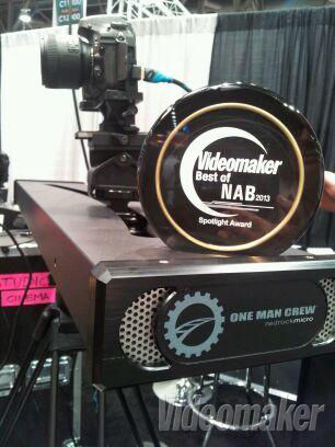 Camera slider with camera and an award on it