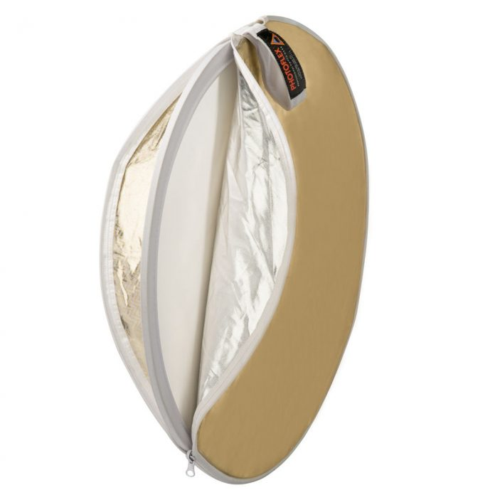 Disc of gold and silver fabric partially unzipped