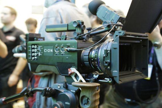 large camera at a tradeshow