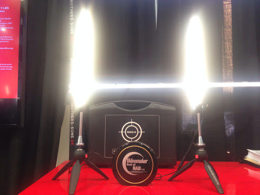 Two standing lights on either side of an award