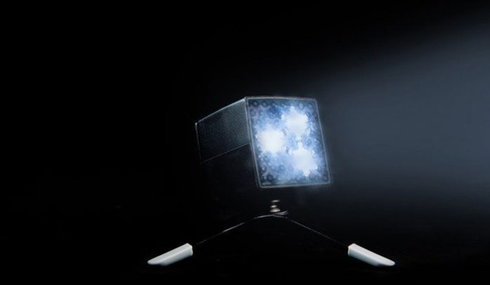 three beams of LED light from a small box on a tripod
