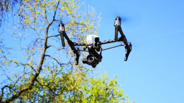 Image of A Drone with its blades spinning