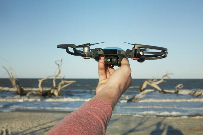 Hand holding a Spark drone