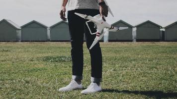 Man holding DJI drone