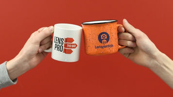 Two mugs touching with Lensrentals and LensProToGo logos on them