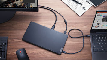Lenovo's Thunderbolt 3 Graphics Dock on a desk plugged into a computer and laptop
