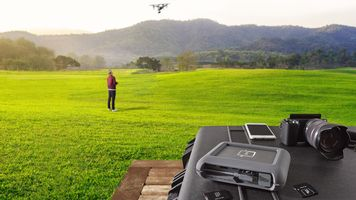 LaCie DJI Copilot with man flying drone in the background