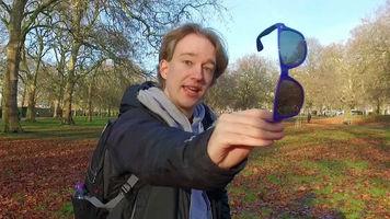 Tom Scott holding a pair of glasses
