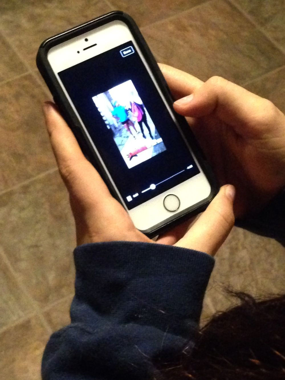 Teen playing with a mobile phone