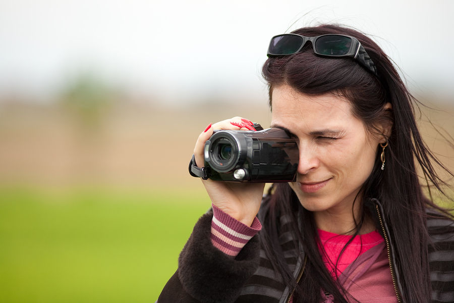 Young woman using a consumer camcorder