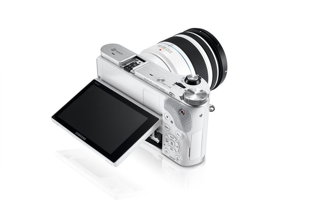 white compact camera with an LCD that tilts up