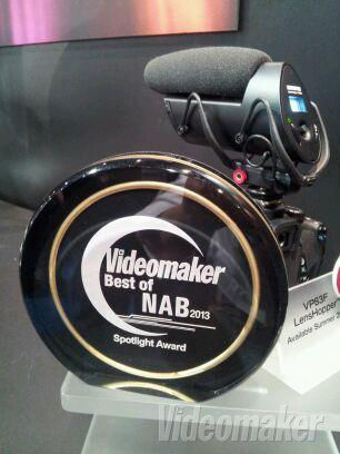 DSLR with a mic/recorder on top behind an award