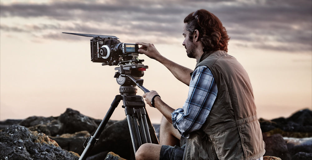 Blackmagic Pocket Cinema Camera outdoors with follow focus, cinema lens, and matte box.