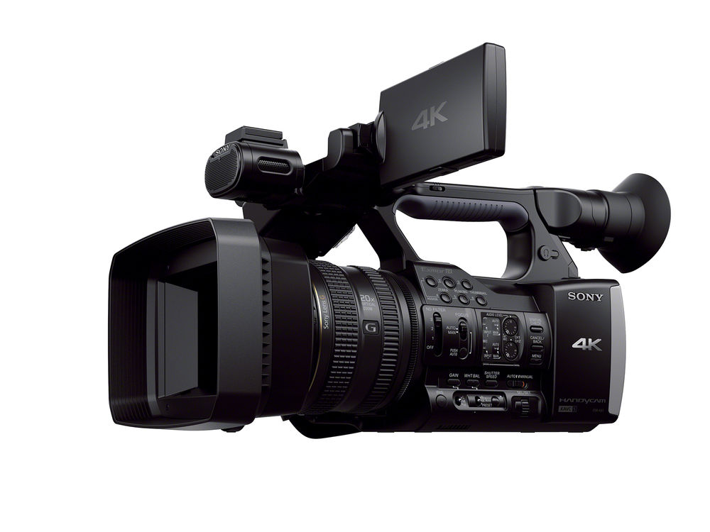professional 4k camera with large lens hood and LCD open