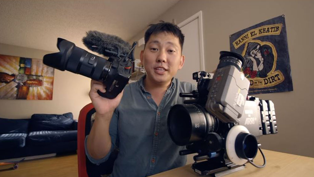 Image of Gene holding a Canon 80D and Arri Alexa