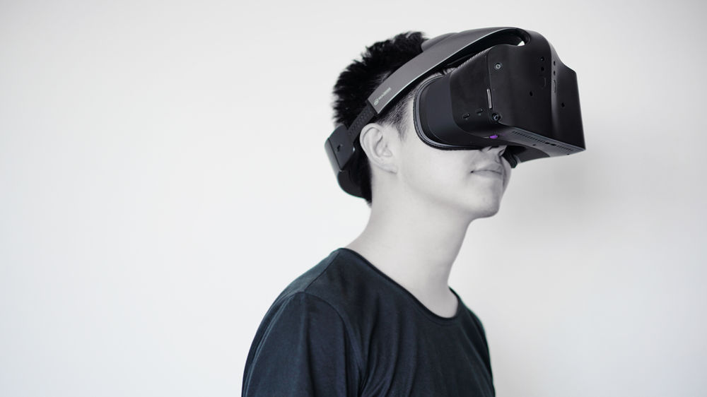 Image of young man wearing Intel's Project Alloy VR headset