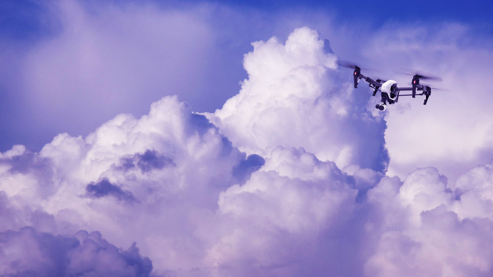 Drone flying in a cluster of clouds