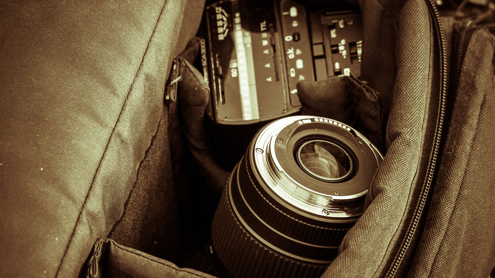 Image of camera a camera body packed into a camera bag