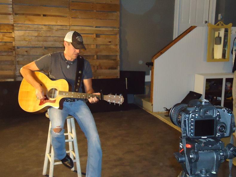 A simple set on the Carl Wayne Meekins' Someday Soon music video shoot .