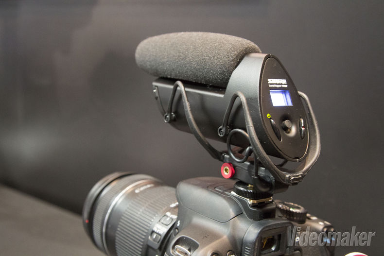 Shotgun mic with recording functions sits atop a DSLR