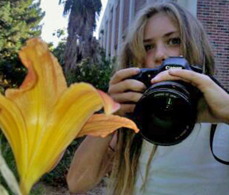 small child with a big DSLR camera