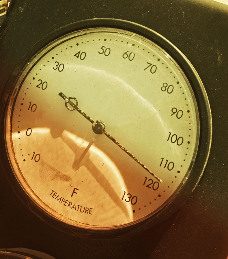 shot of thermometer covered with half orange, half yellow gel with needle pointing at 110-degrees