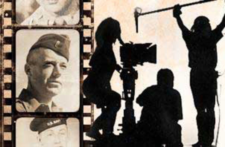 Image of filmmakers along side a film strip from a World War 2 soldier