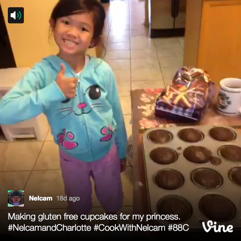 child showing off cupcakes