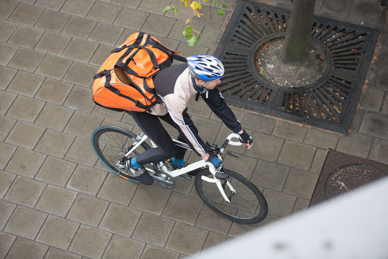 High angle shot looking down on a man on a bicycle