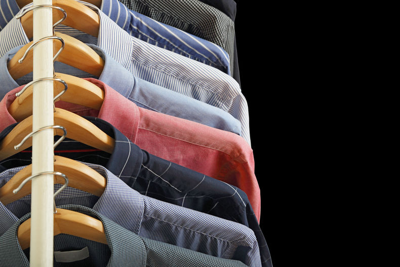 Photo of shirts hanging in a closet