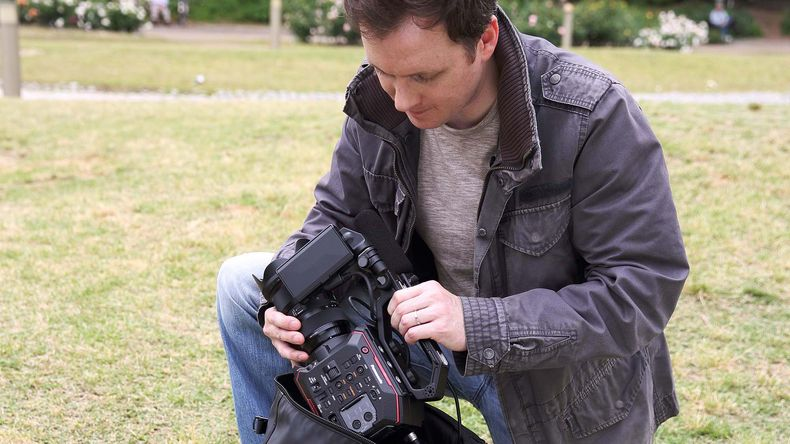 Videographer preparing the Panasonic AU-EVA1 for use