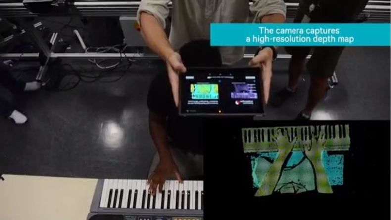 Image of Android phone filming hands playing piano for infrared light rendering