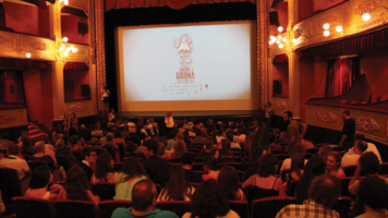 A crowd gathers for a festival screening.