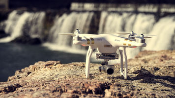 Drone on ground with waterfall in the background