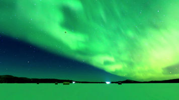 Image of a Lunar Eclipse Happening During the Aurora Borealis