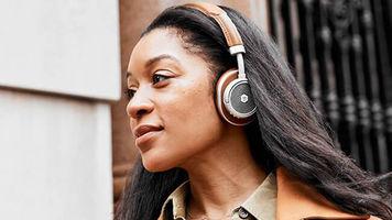 Woman wearing MW50+ headphones