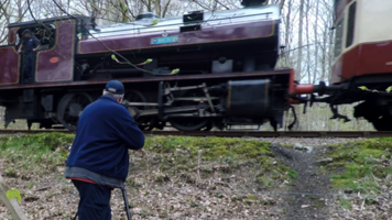Rob Ellerby near a train with his gear