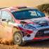 Rally car sliding on a dirt track