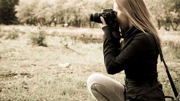girl shooting video with a camera