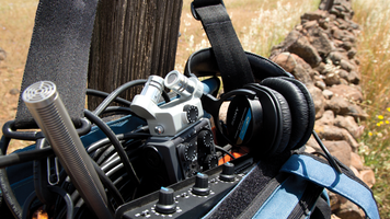 Field audio case with field mixer, mic, audio recorder and headphones.